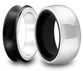 Co-extruded wedding bands in white gold and black titanium.